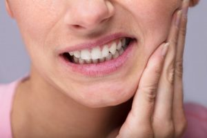 nằm mơ thấy rụng răng hàm dưới